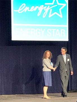 Angela Aeschliman, CPM, CCIM, LEED AP ND, Sustainability Advisory Board chair, accepts IREM's 2018 ENERGY STAR Partner of the Year award from Bill Wehrum, assistant administrator, Office of Air and Radiation, U.S. EPA